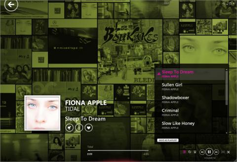 Die Zune-Software beim Abspielen von Musik: Eine Collage aller Alben im  Hintergrund.