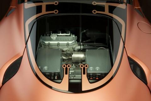 Lotus Evora Hybrid: Unter der Glashaube sitzt kein V6-Motor, sondern ein kleiner 3-Zylinder-Range-Extender. (Foto: Lotus)