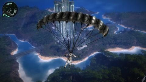 Aus der Luft ortet Rico sein nächstes Ziel: diese Kleinstadt mit Wolkenkratzer.