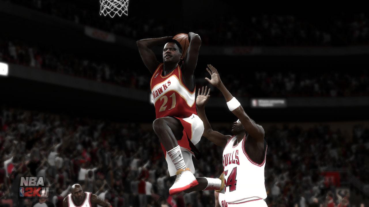 Spieletest NBA 2K11: Eine Zeitreise mit Jordan und Magic - Dominique Wilkins setzt zum Dunking an.