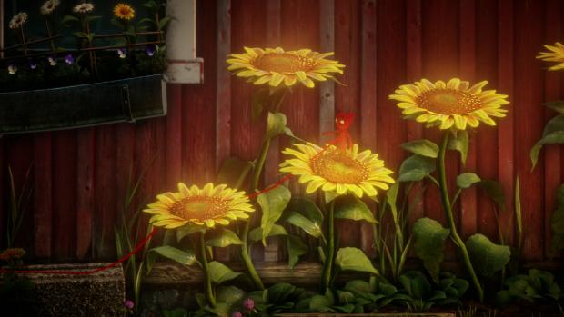 Da geht die Sonne auf: Yarny springt über Blumen. (Screenshot: Golem.de)