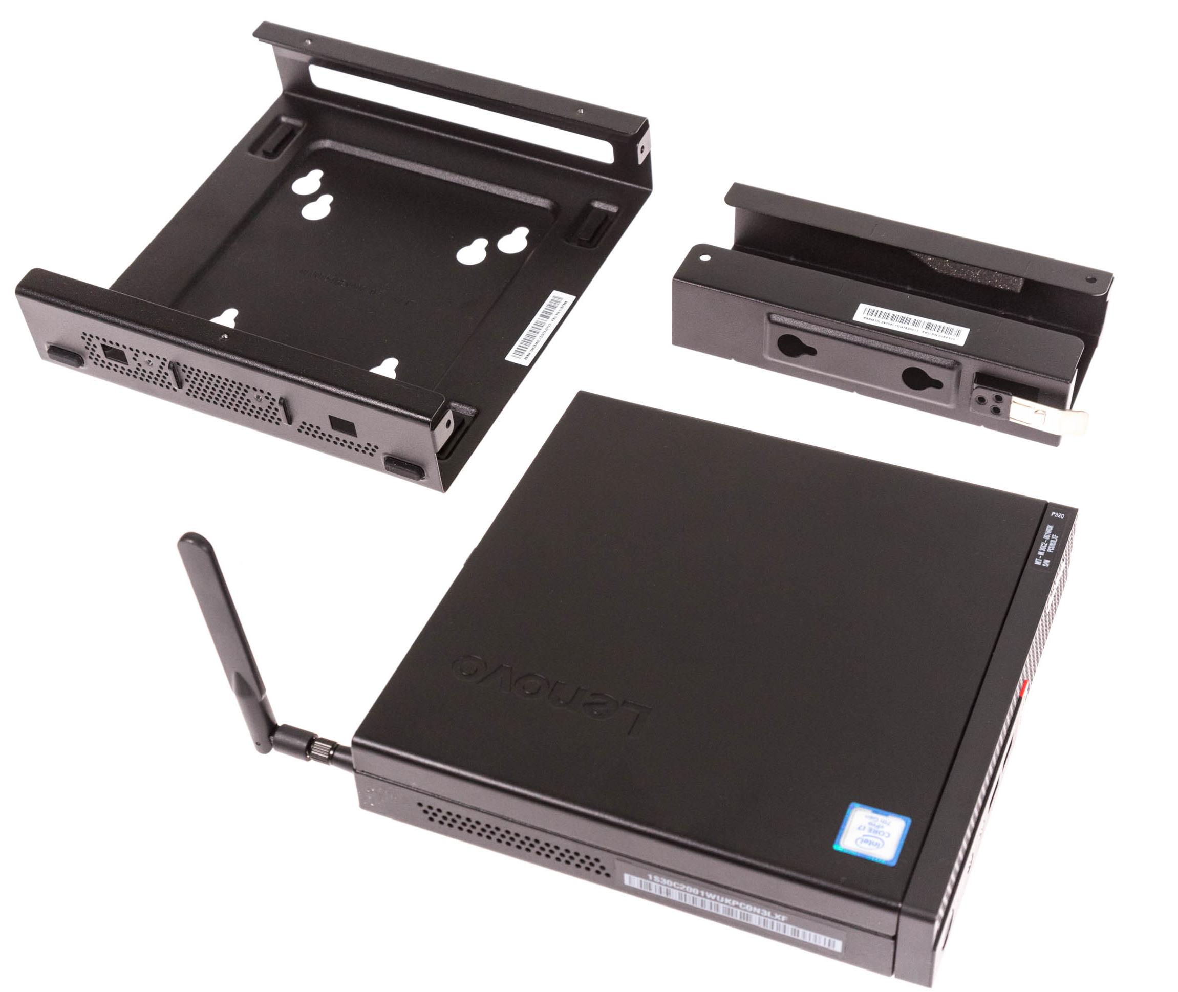 Lenovo Thinkstation P320 Tiny im Test: Viel Leistung in der Zigarrenschachtel - Die zwei VESA-Halterungen dienen der Befestigung des PCs und dessen Netzteil. (Bild: Martin Wolf/Golem.de)
